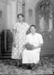 Emilia Amesquita (sitting) and daughter-in-law Isabel Amesquita
