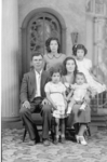 Jesus Pinon, wife Julia Nayarez Pinon, and daughters Mary Lou (tallest, standing in back), Lupe (holding her ruffled skirt out), Julie Pinon (center, front), and baby Hortensia (Terry)