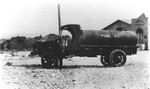 El Paso, Texas. Oil tank truck. Highland park corner of federal St. and Dakota. Methodist church in background.