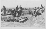 U.S. Soldiers making adobe bricks