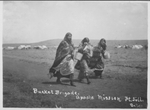 Indian women carrying buckets